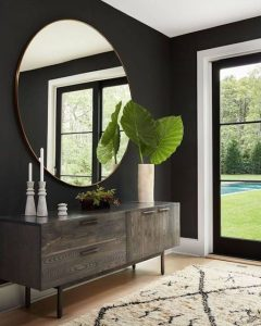 luxurious round mirror makes bedroom sparkle