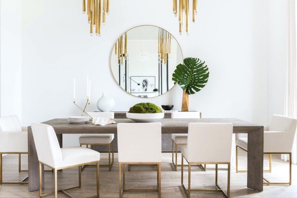 classic round mirror in dining room