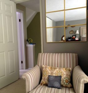 6 small inexpensive mirrors grouped as one large mirror