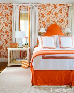 Quadrille orange and white wallpaper, bedroom