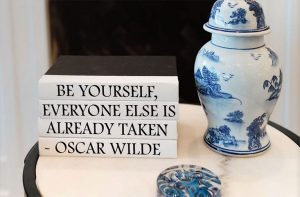 Humorous literary quote made through stack of decorative books.
