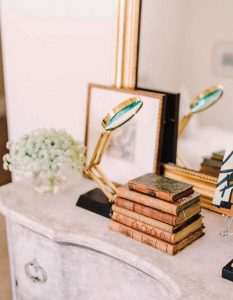 Old world style decorative books add a nice antique touch.