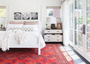 "A red Oriental rug with other touches of red in accents can nicely ""set"" a room."